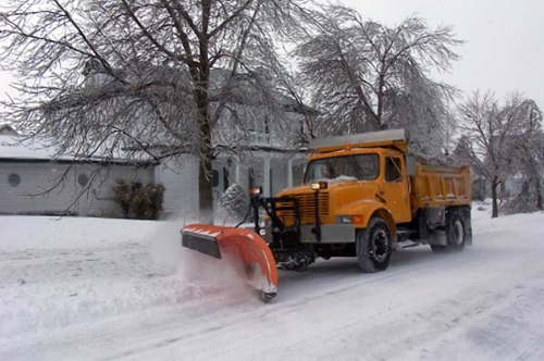 The city is plowing and sanding streets after an overnight snowfall. (CHRISD.CA FILE)